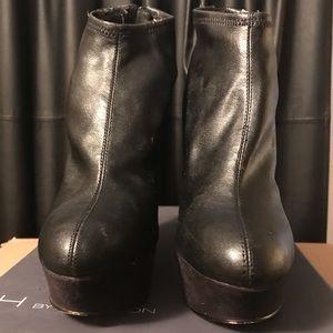 Black leather wedge heels.